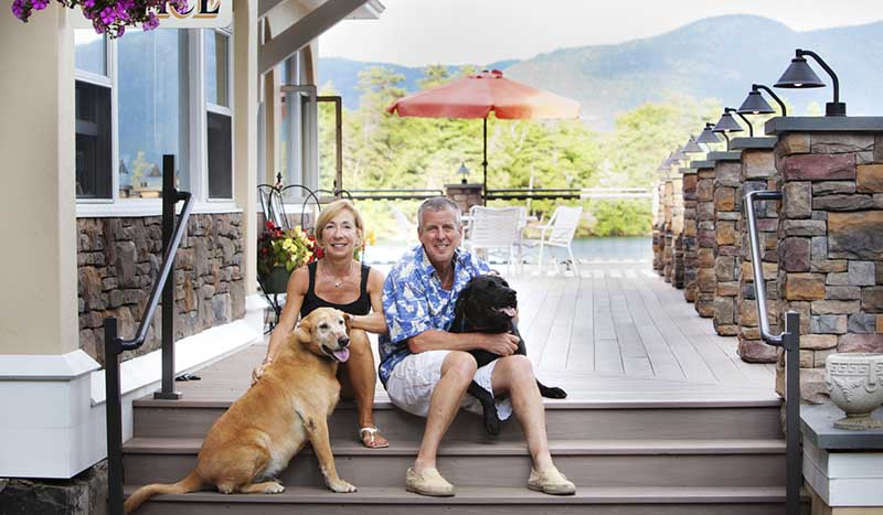 Owners with dogs on deck