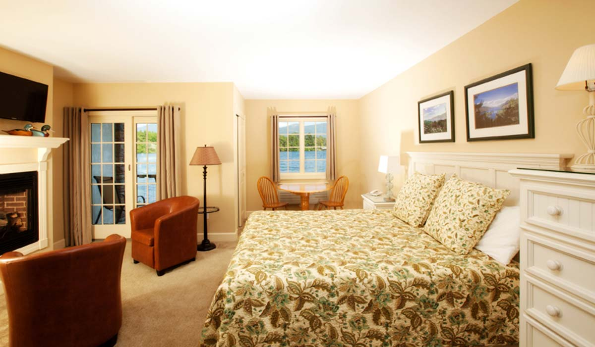 Suite with Fireplace, Bed and Chairs